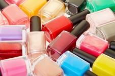 Nail polish colorful bottles background