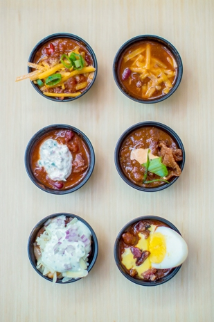 Six chili recipes vie for the title.